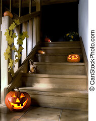 halloween pumpkins on stairs in the house at night