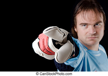 Goalkeeper in action - Goalkeeper gives directions. Studio...
