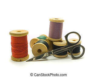 Threads and scissors - An isolated colourful photo of...