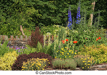 Cottage Garden - Cottage garden in early summer with a large...