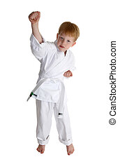martial arts boy - boy in gi making karate moves over white...