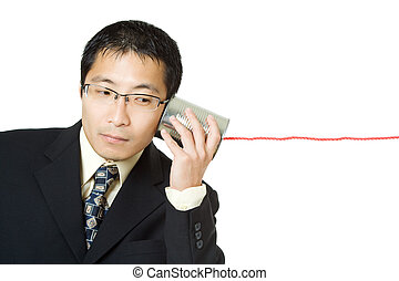 Businessman - An isolated shot of a businessman listening to...