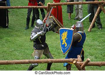 Medieval footed knights, fighting - A fight of medieval...