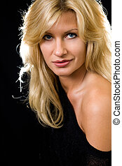 Blond woman - Attractive close up of face of a woman with...