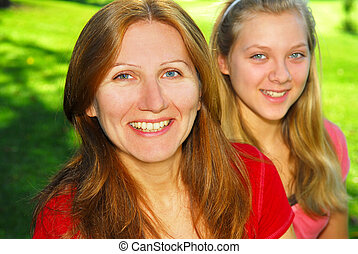 Mother and daughter - Portrait of mother and daughter in...