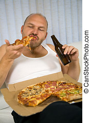 Beer and pizza series - Unattractive overweight man eating a...