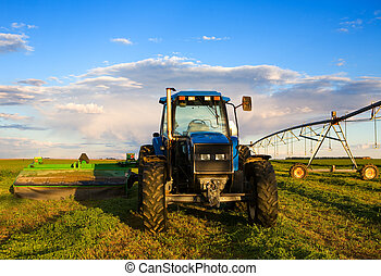 Farm tractor - Farm equipment in the field with blue sky and...