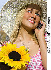 Phonecall and Flowers - A beautiful young blond woman...