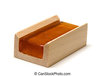 Rosin - An amber colored violin, viola, cello rosin in a...