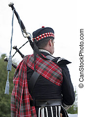 Scottish bagpipes - Musician in full regalia in the Scottish...