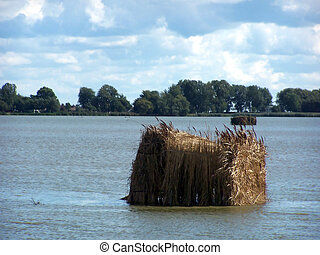 Duck hunting blind in middle of a lake