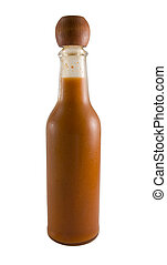 Hot Sauce Bottle - a close up on a bottle of red hot sauce