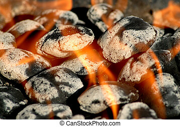 Ready to BBQ - White hot charcoal briguettes with orange...