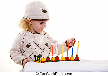 Jewish Child - Young blond hair three year old boy lighting...