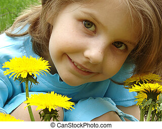 child with dandelions - little pretty smiling girl outdoor...