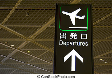 Departure Sign - An airport departure sign in English and...