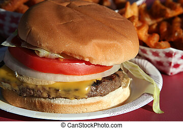 Cheeseburger deluxe & fries, outdoors.