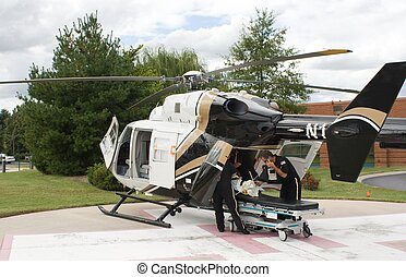 Medical helicopter - A medical helicopter loading a patient...