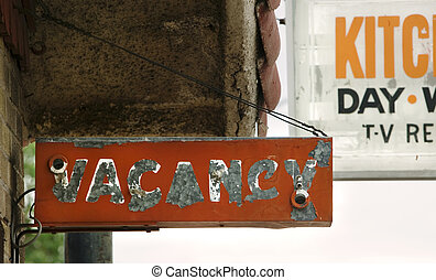 Vacancy Sign - Decrepit and peeling orange motel vacancy...