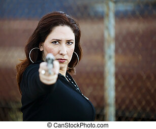 Hispanic Woman with Handgun - Hispanic woman behind a wall...