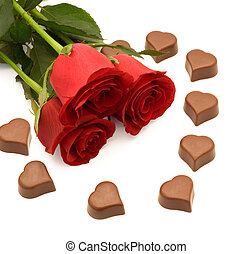 Roses and chocolate - Red roses and heart shaped chocolate
