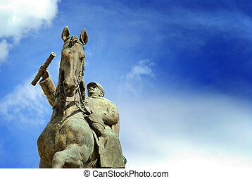 Equestrian Statue of Marechal Joffre against a blue sky, at...