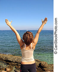 Free woman - A young woman at the coast feeling freedom...