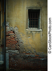 Crumbling Wall with Barred Window and Pipe, Venice, Italy -...