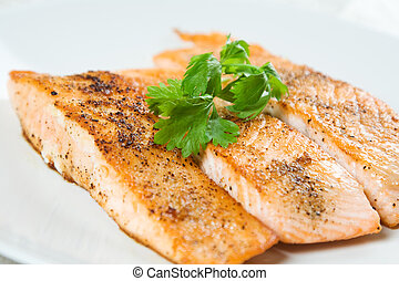 Baked salmon - A shot of baked salmon on a white plate