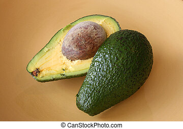 Avacado - Two halves of avocado with the pit still in place...
