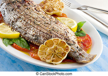 Sea bass - Striped sea bass on a bed of roasted tomatoes