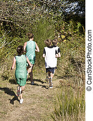 Cross Country Runners on a Wooded Trail - Cross country...