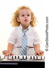 Little musician - Adorable little three year old boy with...