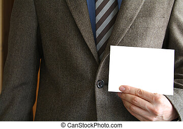 Businessman - Smartly dressed business man holding a white...