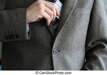 Businessman - Smartly dressed business man putting a credit...