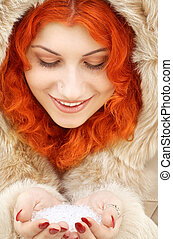 handful of ice - lovely redhead in fur with handful of ice