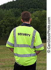 Security Guard - Male security guard wearing standing alone...