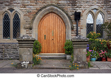 Oak Doorway - Wooden arched doorway of a converted church...