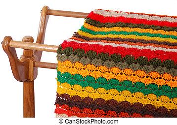 Crocheted Afghan On Rack