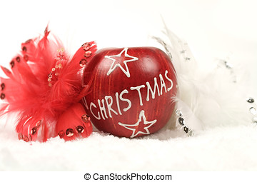Christmas decoration - Christmas apple surrounded by a white...