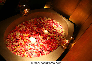 relaxation - spa tub with rose petals