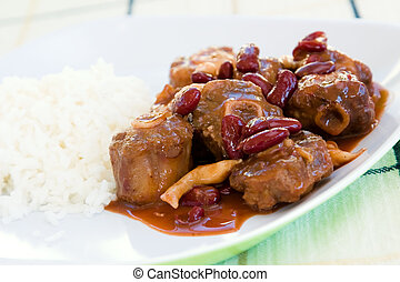 Oxtail Stew with Rice - Caribbean style curried Oxtail stew...