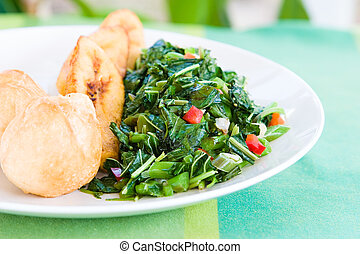 Speciality caribbean dish of callaloo spinach served with...