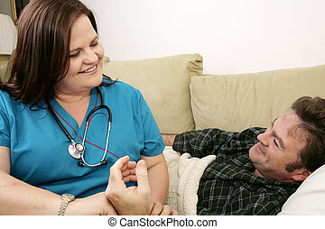 Home Health Care - Kind, friendly home health nurse taking...