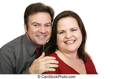 Happy Couple in Red - A good looking, loving couple in red -...