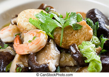 Chinese food - A closeup shot of seafood casseroles, a...