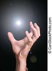 Hand grasping for light - A hand grasps for a light