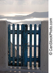 Blue Gate - Blue gate on a white fence overlooking the...