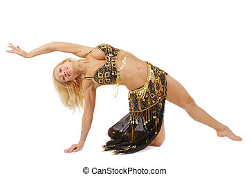 Belly-dance - Blond tanned girl in golden and black oriental...