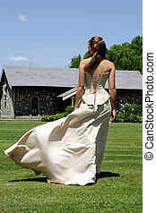 Bride Wind - A bride walking outside and wind blowing her...